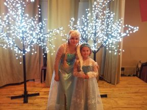Elsa poses with a visitor